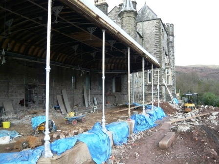 Conservatory terrace being dug down to original level and low stone wall (covered) being repointed