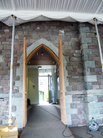 Entrance arch to Conservatory rebuilt in stone - old breeze blocks replaced with stone
