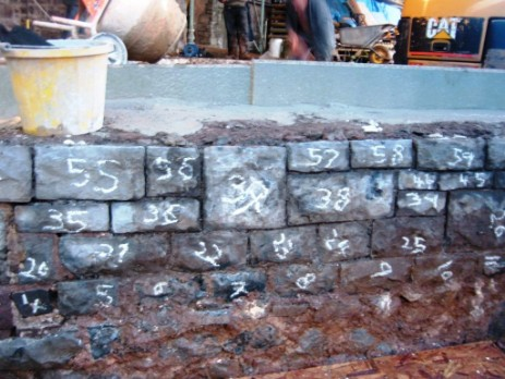 Conservatory wall reinstated - see all numbered stones so they were all put back in right order
