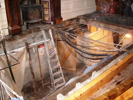Old floor joists removed, new floor joists benig installed in the Patti bar
