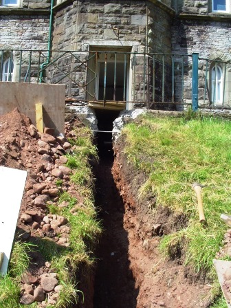 Brecon Beacons Hotels Craig y Nos Castle Trench for new electric cabling into back of castle via cellars and embankment