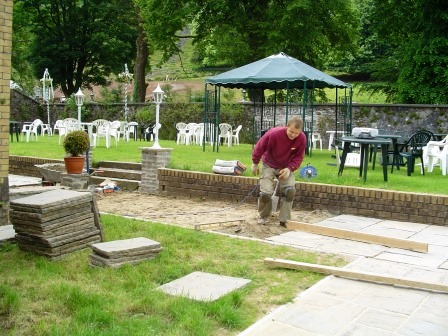 Laying the patio paths around the side and back of the theatre at Craig y Nos Castle