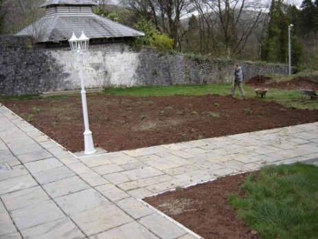 Laying the footpaths behind theatre, landscaping the grounds and recreating the walled gardens