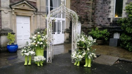 Decorative arch outside theatre used for photos with enhanced flower decoration added by a wedding couple
